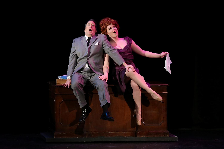 J. B. Biggley (Steven Martin) and Hedy LaRue (Corinne Littlefield)